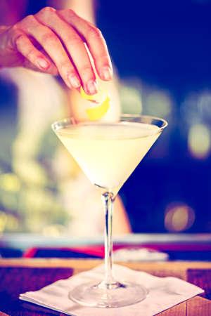 Bartender preparing Limoncello martini coctail.