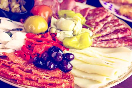 Appetizers plate with antipasto in Italian restaurant. 版權商用圖片