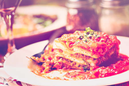 Homemade Lasagna on the table in Italian restaurant.