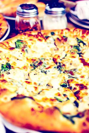 pine nut: Fresh chicken pine nut pizza in Italian restaurant. Stock Photo