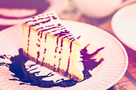baileys: Fresh Italian Baileys cheesecake with coffee on the table.