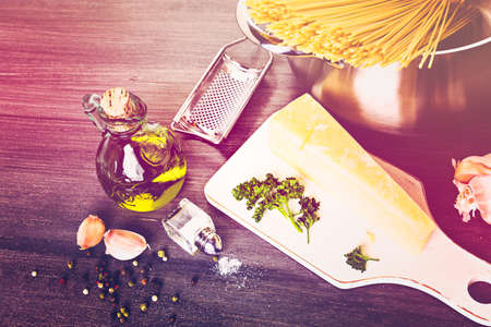 Cooking organic pasta with garlic herbs and parmesan cheese. Stock Photo
