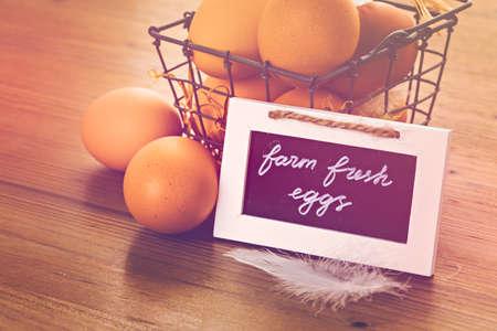 Fresh farm eggs on the wood table. Stock Photo
