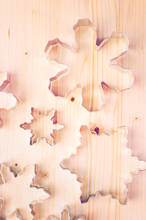 cookie cutters: Different size metal cookie cutters in shape of snow flakes. Stock Photo
