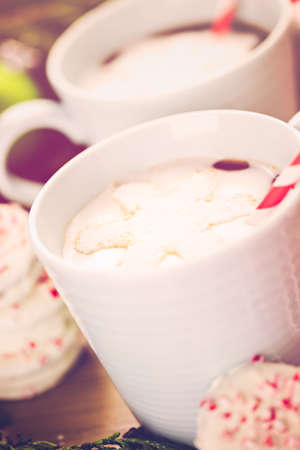 baked treat: Homemade hot chocolate garnished with snowflake shaped white marshmallows. Stock Photo