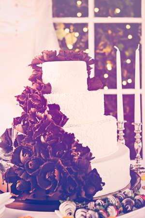 tiered: Gourmet tiered wedding cake at wedding reception.