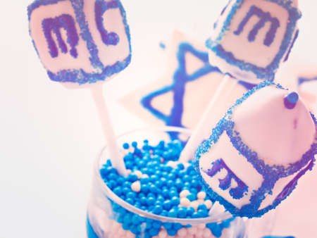 dreidel bears: Gourmet dreidels decorated with white icing for Hanukkah.
