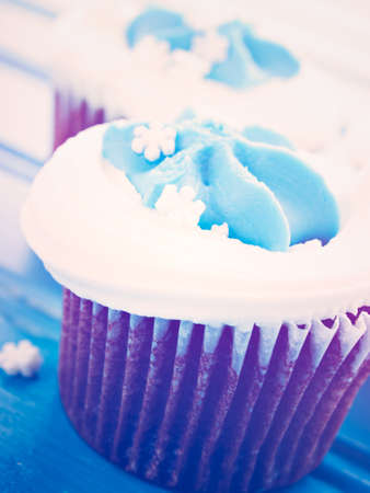 khanukah: Gourmet chocolate cupcakes with white and blue icing.