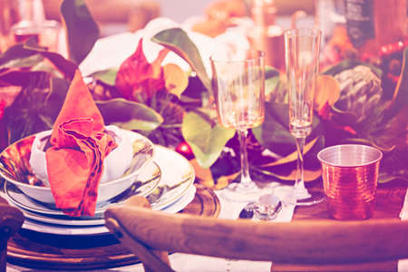 Elegant table prepared for Thanksgiving dinner with family and friends.
