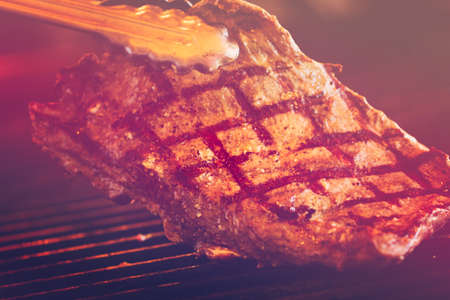 Slice of beef on barbecue grill.