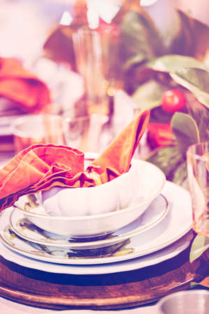 napkin ring: Elegant table prepared for Thanksgiving dinner with family and friends.