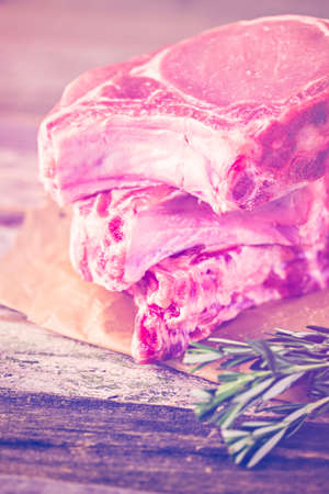 homely: Organic pork lion chops of thick cut with rosemary.