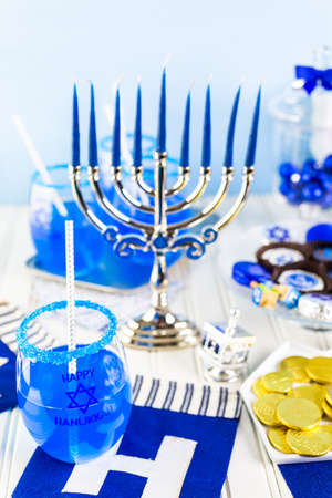gelt: Table set with cocktails and chocolates to celebrate Hanukkah.