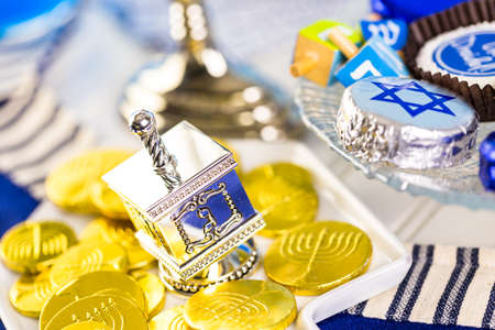 dreidel bears: Table set with cocktails and chocolates to celebrate Hanukkah.