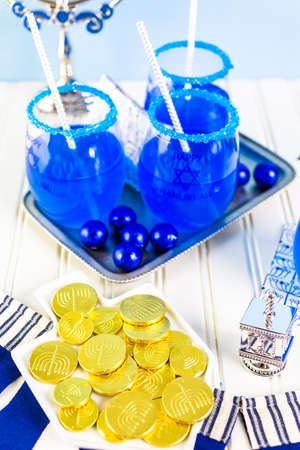 khanukah: Table set with cocktails and chocolates to celebrate Hanukkah.