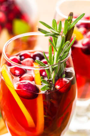 distilled alcohol: Holiday cranberry sangria with apples and cinnamon.