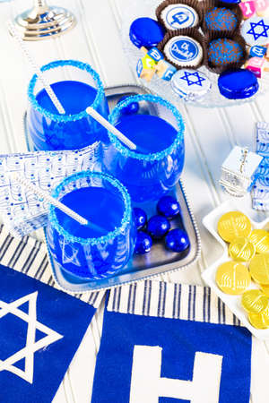 hebrew alphabet: Table set with cocktails and chocolates to celebrate Hanukkah.