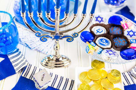 candelabrum: Table set with cocktails and chocolates to celebrate Hanukkah.