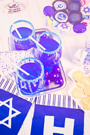 Table set with cocktails and chocolates to celebrate Hanukkah.