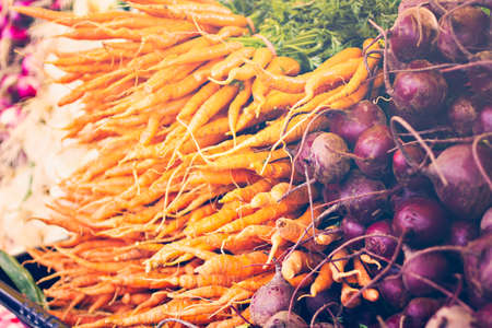 etymology: Organic orange carrots on a display at the local farmers  market.