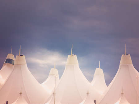 is well known: Denver International Airport well known for peaked roof. Design of roof is reflecting snow-capped mountains. Stock Photo