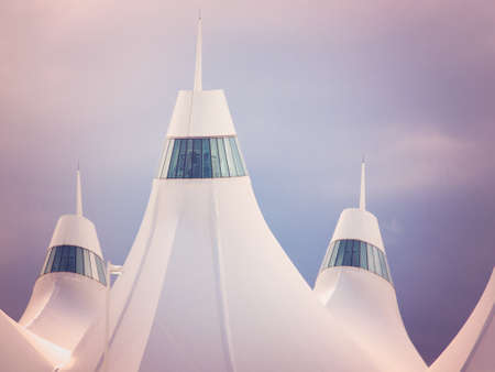 peaked: Denver International Airport well known for peaked roof. Design of roof is reflecting snow-capped mountains. Stock Photo