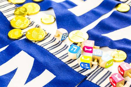 dreidel bears: Colorful Hanukkah dreidels and gold gelt on the table. Stock Photo