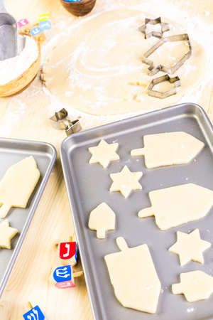 hebrew alphabet: Baking sugar cookies for Hanukkah.