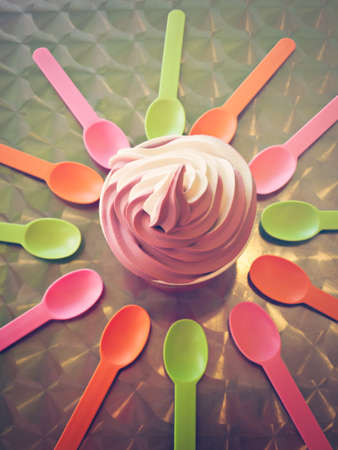 frozen food: Spoons and cup with frozen soft serve yogurt. Stock Photo