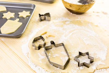 dreidel bears: Baking sugar cookies for Hanukkah.