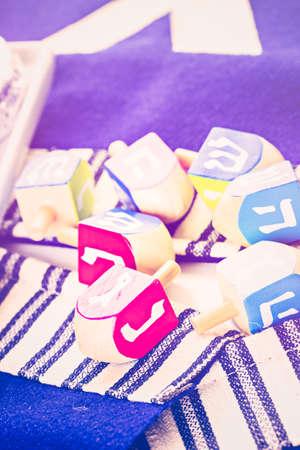 dreidel bears: Colorful Hanukkah dreidels on the table. Stock Photo