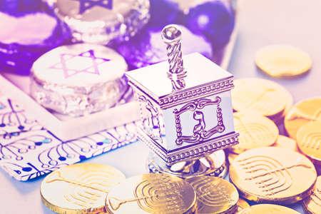 hebrew alphabet: Hanukkah dreidel and gelt on the table.