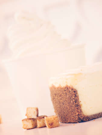 serve: Cup of cheesecake frozen yogurt or soft serve ice cream. Stock Photo