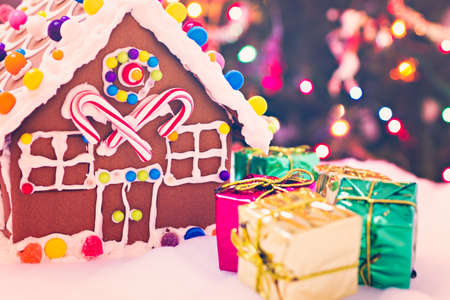 gingerbread house: Gingerbread house with small presents.