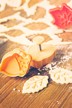 stamper: Cutting out Autumn leafs with cookie stamper to decorate pumpkin pie.