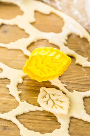 pastry cutters: Cutting out Autumn leafs with cookie stamper to decorate pumpkin pie.
