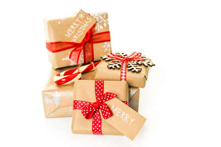 nad made: Christmas gifts wrapped in brown paper with red ribbons.