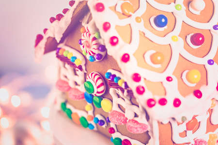 gingerbread house: Gingerbread house decorated with white royal icing and bright candies.