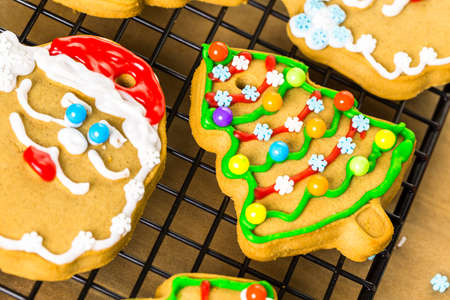decorating: Decorating gingerbread cookies with royal icing and colorful candies.