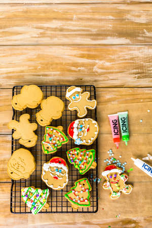 baked treat: Decorating gingerbread cookies with royal icing and colorful candies.