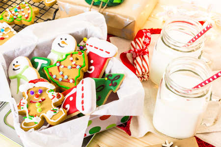 baked treat: Home made Christmas cookies decorated with colorful icing.