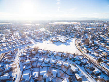 signle family: Aerial view of residential neighborhood covered in snow.