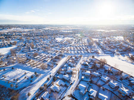 signle: Aerial view of residential neighborhood covered in snow.