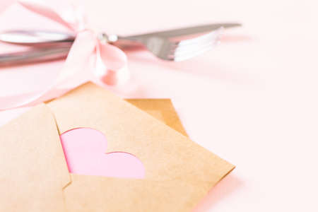 mode made: Utencils with pink ribbon on pink background.