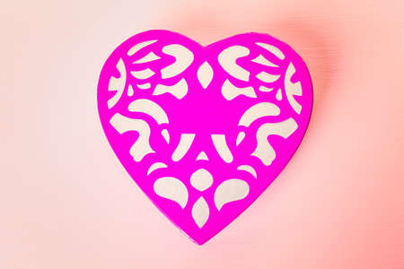 heart shaped box: Chocolates in heart shaped box on pink background.