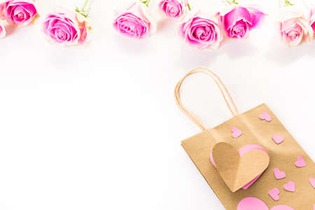 gift bag: Pink roses and hand crafted gift bag on a white background.
