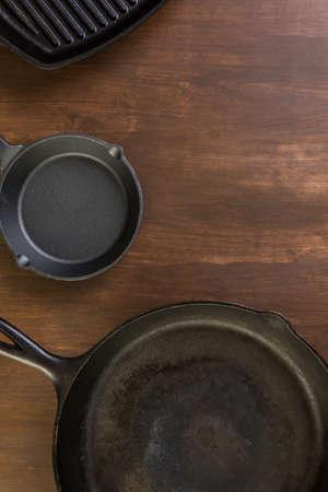 skillet: Cast iron skillet on rustic wood table.