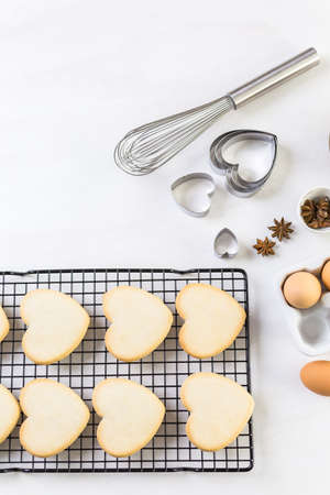 sugar cookie: Baking heart shaped sugar cookies for Valentines Day. Stock Photo
