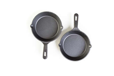traditional cast iron skillet on a white background.