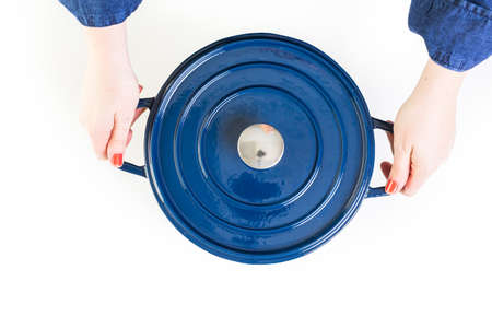 Enameled blue cast iron covered dutch oven on a white background.